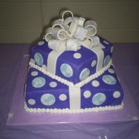 Another Gift Cake Inspired by all the wonderful cakes here. BC with fondant accents. The bow matches the napkins