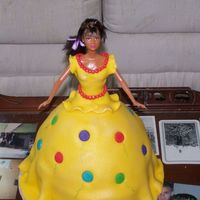 Birthday Balloon Dress Doll My First doll cake for a friend's daughter. Red Velvet cake torted with and covered in cream cheese icing, then with fondant