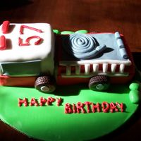 Firetruck Cake Chocolate cake I did for a friend's father who is a firefighter. Everything's fondant (wheels are chocolate fondant)