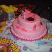Pretty In Pink Dress Up Cake Covered in Fondant, The tiara, pearls, lipstick, sunglasses, etc are all edible