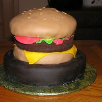 "Burger Cake This burger is made of cake layers covered in fondant. I left the ""burger"" pattie un-iced for the texture of a hamburger. It&#039..."