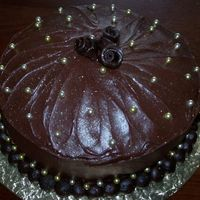 "Chocolate Decadence I have a friend who insists every year he justs wants a ""plain chocolate cake"". I tell him I have so much fun decorating cakes,..."