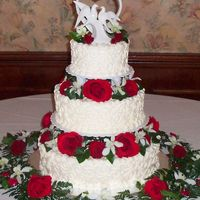 Red & White Wedding Cake   tower style wedding cake with fresh red & white flowers between the tiers