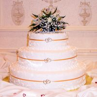 Ribbon & Charms Wedding Cake  Simple wedding cake with random scrolls & dots in the design. Bride provided the entwined heart charms to add to the thin ribbon on the...