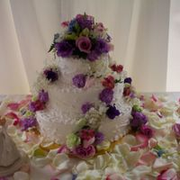 Floral Garden Wedding Cake  This is one of my favorite cakes I have done. The design has random vines and fresh mixed flowers. The table of rose petals made the...
