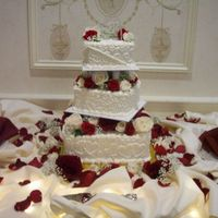Off-Set Square Wedding Cake off-set square wedding cake with fresh flowers between tiers