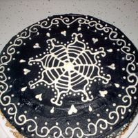 Henna Inspired Cake   Inspired by my fav henna design. Black frosting with white royal icing desighn