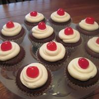 Cherry Cola Cupcake chocolate/cola cupcake with cherry preserve filling, topped with vanilla cream cheese icing and a cherry tfl