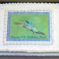 Hummingbird Hummingbird edible image with dragonflies.