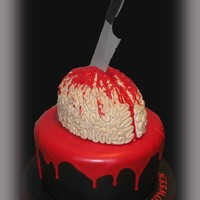 Bloody Brain Cake   Brain Cake. This is a red velvet cake including the brain. The knife is made of sugarpaste and the blood is chocolate candy melts.
