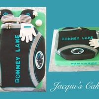 Golf Bag  This cake was for a school banquet for the golf team. Yellow cake, chocolate ganache filling, and decorated with fondant accents. Thanks...