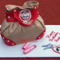 "Purse Cake Mini purse cake. 4"" x 8"" chocolate cake filled with strawberry IMBC. Everything is fondant. The photo is an edible image of the..."