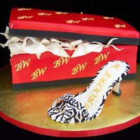 Zebra Print High Heel Shoe And Shoe Box The shoe box and lid are cake. The high heel shoe is made from sugarpaste with hand painted zebra stripes