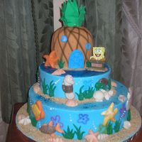"Spongebob  14"" inch, 10"" inch, and the pineapple is 6 inch. Pineapple covered in fondant, all othersbuttercream. All decorations are..."