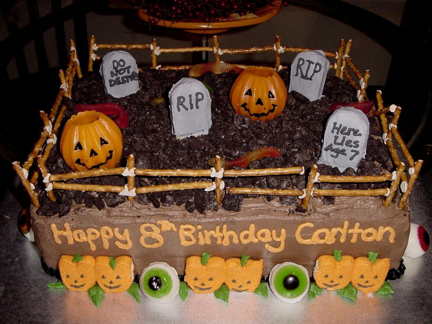 Halloween Graveyard/birthday Cake Fun and festive cake for a boy's halloween birthday!! He wanted to it be spooky!!