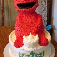 First Birthday Elmo Cake Yeah, it's finally done!! I was having anxiety about doing this cake. I did the test Elmo and he came out great. But, when I did the...