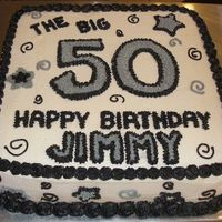 The Big 5-0   Cake is decorated in buttercream using the birthday boy's favorite colors.
