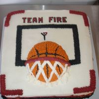Basketball Cake  This cake was made for my nephew's YMCA basketball team. 14 inch chocolate cake with cherry filling, iced and decorated with...