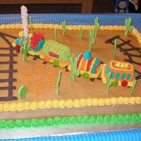 Choo Choo Train Cake  This is a train cake i did for my nephew's 2nd Birthday. He adores trains, so i made the track and the cacti using fondant since we...