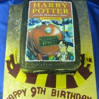 Harry Potter Marble cake, buttercream filling, fondant finish with an ediable image for the cover. The scarf is also make of modeling paste