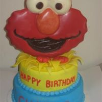 Elmo Cake This is my version of the 2008 Wilton Yearbook Elmo cake. The Elmo head is made out of candy melts, the bursts and hands are gumpaste. The...