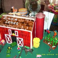 Red Barn  Barn is 9 x 13 with 6 layers of cake, 2 each of butter, chocolate and funfetti. The silo is a pringles can covered in gumpaste. The board...