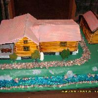 Cabin Side 1  This cake was for a 70 year old. It is the cabin he built and his daughter wanted it in cake form. The 2 cabins and the barn are cake....