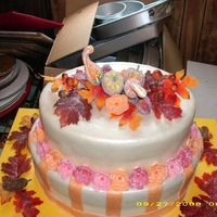 Fall Wedding Theme   Chocolate cake with starburst flowers.