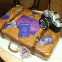 Vintage Suitcase With Camera  This is a vintage style suitcase with travel stickers and camera and passport.White cake covered with fondant. Buckle and camera lens and...
