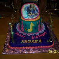 Hannah Montana   covered in fondant. edible image on top. top layer is gold luster dust. cake was airbrushed