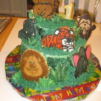 It's A Jungle Out There! cake decorated with sugar cookies frosted with buttercream