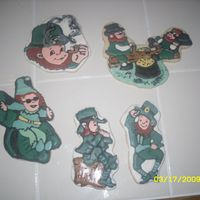 The Whole Leprechaun Gang Sugar cookies with royal icing. I think the leprechaun sliding down the shamrock looks like it joined the witness protection program, LOL...