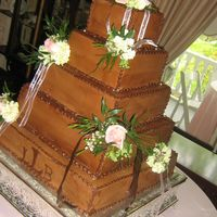 Chocolate Beauty!! This is my first chocolate (or even colored) wedding cake!! I absolutely loved it and the bride and guests did too! The small pink flower...