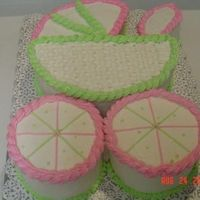 Baby Buggy 3-D baby buggy cake for baby shower. Decorated in pink/green/white buttercream with rope borders, basektweave, and other accents.