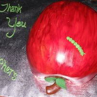 Apple Cake This was carved from several round cakes, filled and stacked. Covered in fondant, painted with gel color.