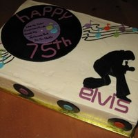 Elvis Silhouette This is a sheetcake I made for a friend's mom - she is crazy for Elvis! I just made a large and a few small records from black fondant...