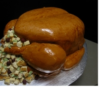 Turkey & Stuffing Turkey completely made of red velvet cake, covered in fondant, painted with a brown glaze. Stuffing made from sugar cookies cut in pieces,...