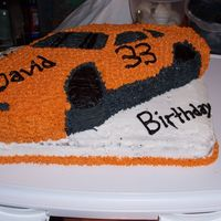 Car Cake   my brother is a fan of tony stewart so I tired to use his colours the best I could.
