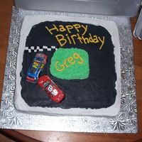 Race Cake  I tried to make this cake like a race track but didn't have the pan I wanted so I improvised it worked and my brother is a fan of dale...