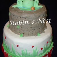 Frog Prince Frog Prince with a golden ball sitting on a stone well. Fondant.