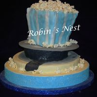 Popcorn For my brother-in-law who graduated from Movie Director´s school. Fondant and chocolate/ dulce de leche inside.