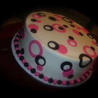 Hot Pink, Black Funky Circles Graduation cake, made cupcakes to match.