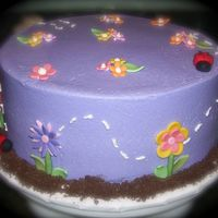 Garden Party Garden party themed birthday party. Butter cream frosting, fondant accents.