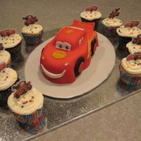 Lightning Mcqueen With Cupcakes I added cupcakes for additional servings as this cake is pretty small. I used the theme cupcake liners and little picks to make it more...