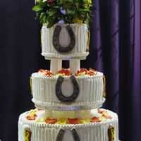 Western_Wedding_Cake.jpg This is how the cake looked after I remembered to add the decorations.