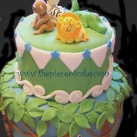 Jungle Jungle Theme Cake covered in MMF. All animals hand sculpted.