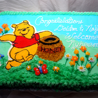 Winnie The Pooh This was my 1st fbct. It was fun to make. Winnie the pooh made for a baby shower. Yellow cake with buttercream icing.