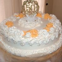 "50Th Wedding Anniversary Cake This was a cake I made for a friend's parents. It is a two layer 14"" lemon cake with lemon filling. It's all Buttercream. My..."