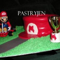 Mario's Hat This is a last minute Mario Kart inspired cake covered in red MMF. I tried my hand at carving so that the hat had a bit of shape, I should...