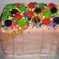 Treasure Chest Treasure chest is covered with chocolate BC, broken ring pops and yellow nerds as the jewels and gold. Wood is chocolate MMF.